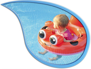 Small child in floatation device looking away while floating in a pool under supervision